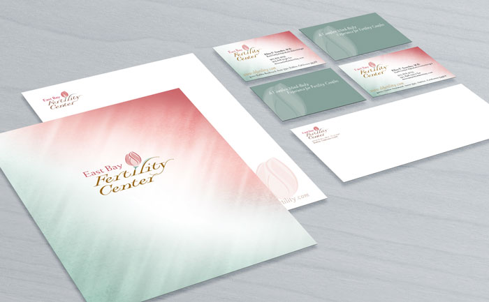 Logo and branding design for East Bay Fertility, displayed on stationery, business cards, and envelope